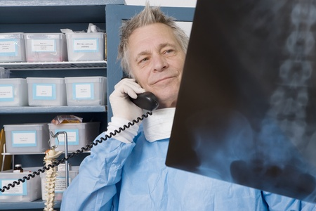 Senior medical practitioner stands with xray Stock Photo - 12738047