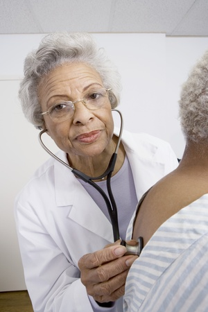 Senior medical practitioner examines breathing with stethoscope Stock Photo - 12738050