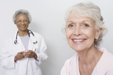 Portrait of senior medical practitioner and patient Stock Photo - 12738061