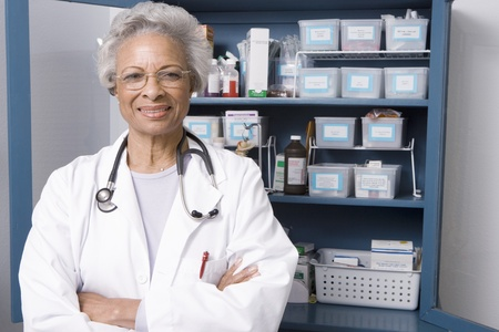 Portrait of senior medical practitioner and medicine cabinet Stock Photo - 12738062