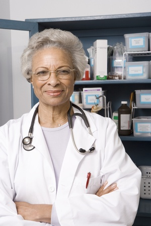 Portrait of senior medical practitioner and medicine cabinet Stock Photo - 12738063