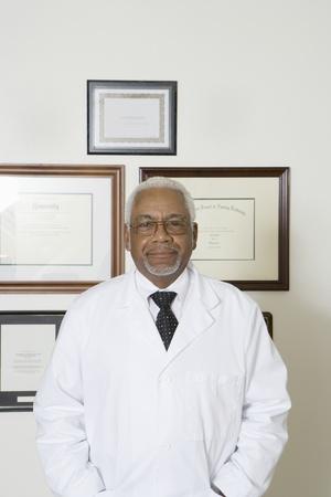 Senior medical practitioner and framed certificate Stock Photo