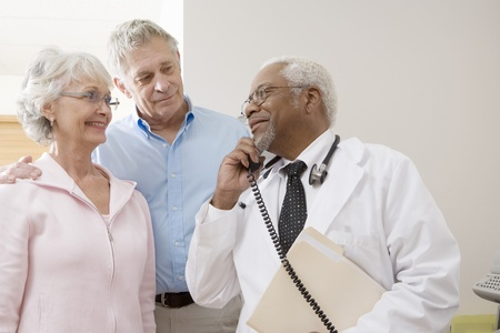 Senior medical practitioner on the phone with a senior couple Stock Photo - 12738068