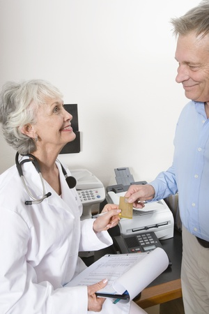 Senior medical practitioner and clipboard Stock Photo - 12738070