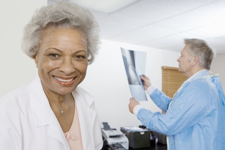 Senior medical practitioner and clipboard Stock Photo - 12738071