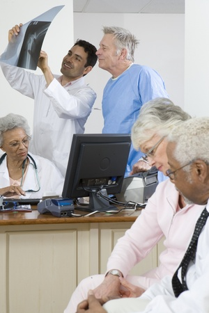mixed age range: Crowded doctors surgery LANG_EVOIMAGES