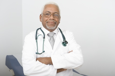 Senior healthcare professional stands with arms folded Stock Photo - 12738077
