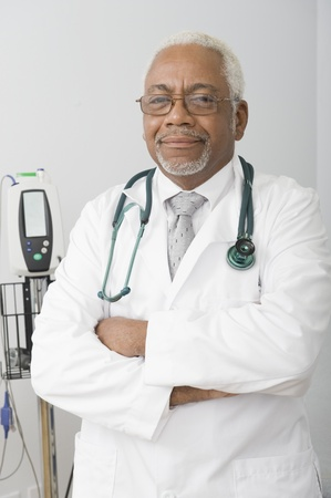 Senior healthcare professional stands with arms folded Stock Photo - 12738078