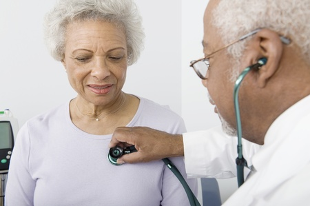 doctor woman: Senior healthcare professional examines female patient