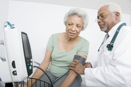 Elderly woman and senior practitioner during medical check-up Stock Photo - 12738086