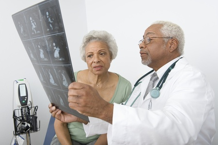 Senior practitioner  and patient examine xray Stock Photo - 12738087