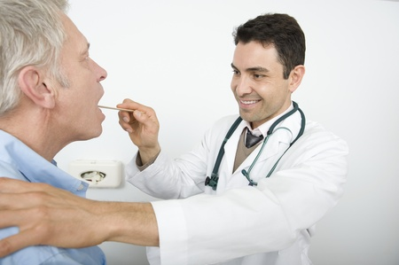 Male doctor examines senior patient Stock Photo - 12738106