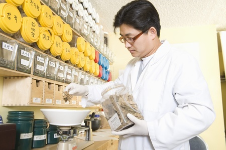 Medical practitioner weighing out ingredients Stock Photo - 12738118