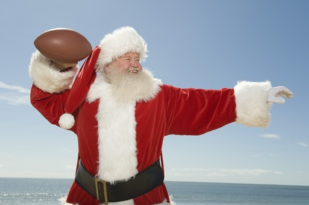 Father Christmas prepares to throw a rugby ball Stock Photo - 12738127