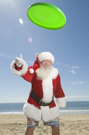 frisbee: Father Christmas throws a green fisbee