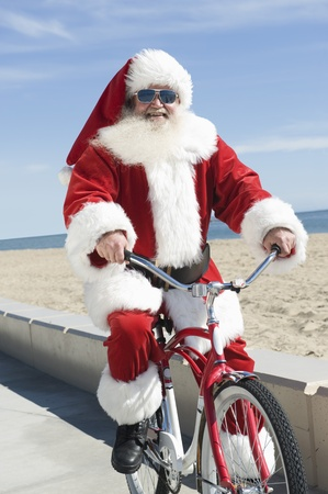 recreational sport: Father Christmas cycles along promenade LANG_EVOIMAGES