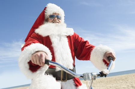 'cycles: Father Christmas cycles along beach front