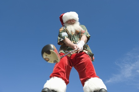 golf of california: Father Christmas stands with gold club