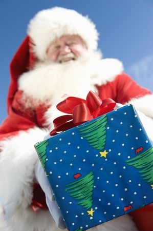 Father Christmas gives a present low angle view Stock Photo - 12738145