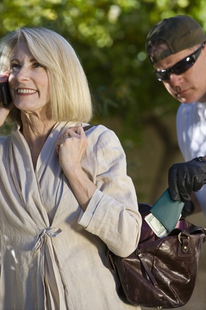 Pickpocket lifts wallet from woman's handbag Stock Photo - 12738148