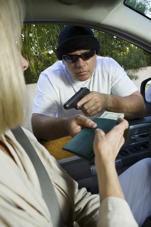 Man assaults woman with firearm through car window Stock Photo - 12738149