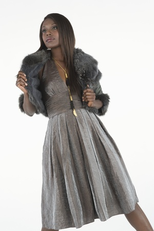 Fashion model in grey dress with fake fur stole Stock Photo - 12738170