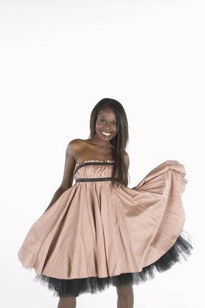 Model stands smiling in pink dress with petticoats Imagens