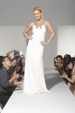 fashion model catwalk: Woman stands in bridalwear on fashion catwalk