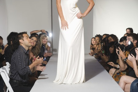 low section: Low section of woman on fashion catwalk