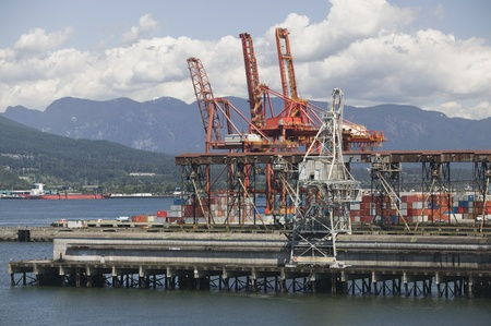 Cranes on pier of Vancouver Harbour British Columbia Stock Photo - 12738229