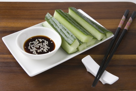 Soy sauce cucumber and sesame seeds with chopsticks Stock Photo - 12738265