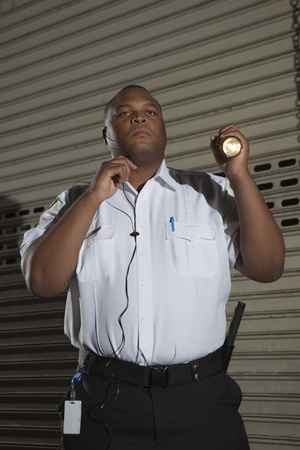 Security guard patrols with torch Stock Photo - 12735799