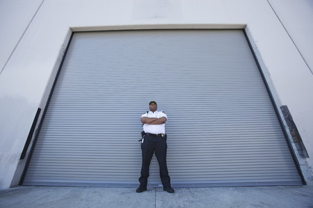 Security guard protects warehouse entrance Stock Photo - 12735510