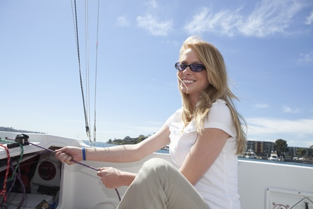 Young woman sailing Stock Photo - 12738272
