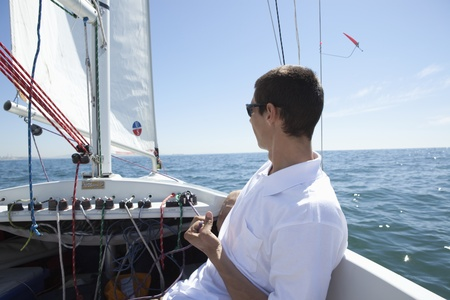 Young man sailing Stock Photo - 12738277