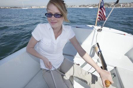 Young woman sailing Stock Photo - 12738280