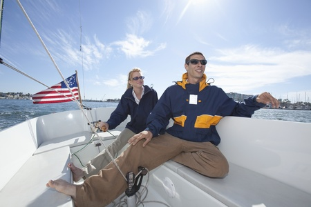 Young couple relax on deck of sailing boat Stock Photo - 12738284