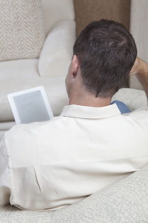Man sits reading a digital book Stock Photo - 12738287