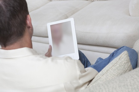 Man sits reading a digital book Stock Photo - 12738288