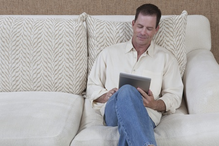 Man sits reading a digital book Stock Photo - 12738292