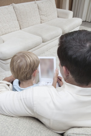 Father and son read a digital book Stock Photo - 12738305
