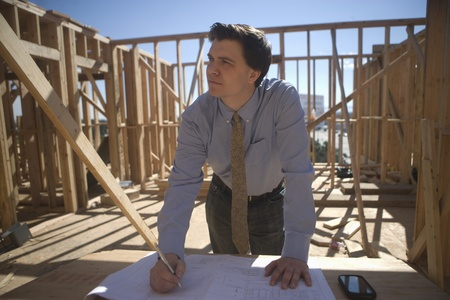 Site manager with building plans Stock Photo - 12738368