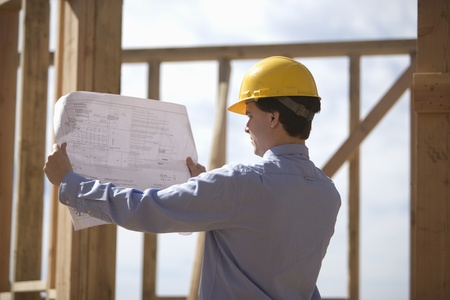 foreman: Site manager with building plans LANG_EVOIMAGES