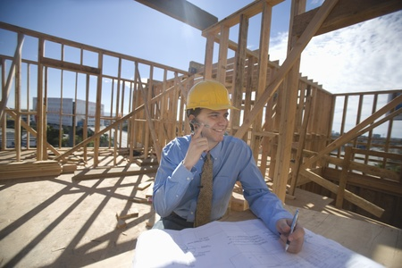 Site manager with building plans Stock Photo