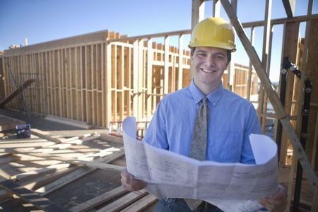Site manager with building plans Stock Photo - 12738386