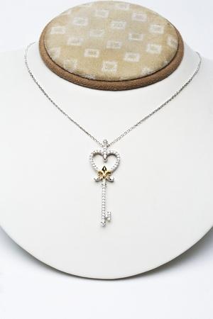 18k white gold key pendant with 0,50 carat diamonds Stock Photo - 12738405