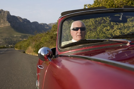Senior man in vintage racing car on Signal Hill  Cape Town  South Africa Stock Photo - 12738408