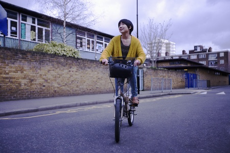 A young female adult riding her bicycle Stock Photo - 12738444