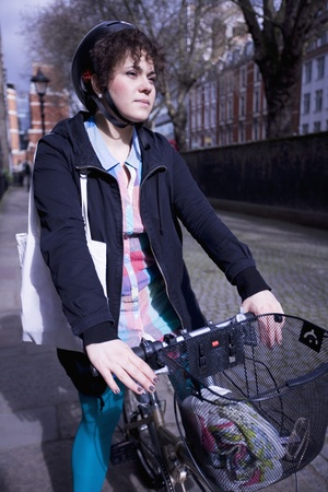 A female adult riding her bicycle Stock Photo - 12738445