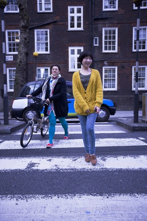 Two female adults walking across the zebra crossing Stock Photo - 12738446